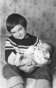 Dom holding Christian